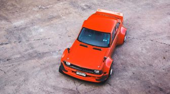 Красная Toyota Corolla KE25 на роторном 13B6